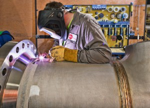 Team Industry welder welding a pipe.