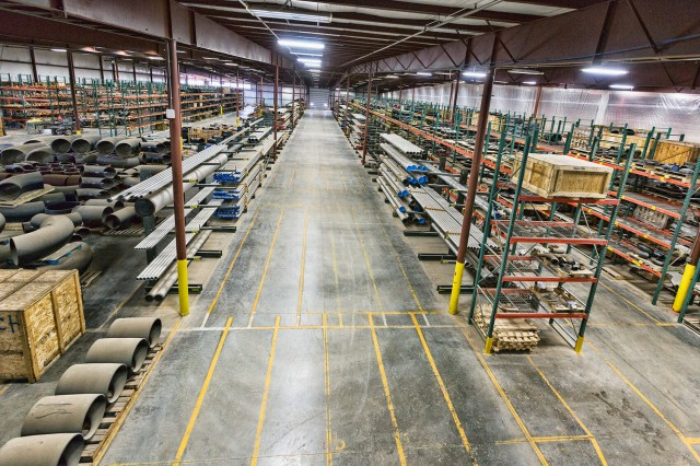 Team Industries warehouse storing supplies and equipment for pipe fabrication.